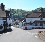 The village nestles on the slopes of a diverse, beautiful valley, rich in meadow, pasture land and wooded cleaves